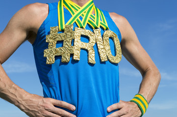 Hashtag gold medal athlete in blue shirt outdoors close-up