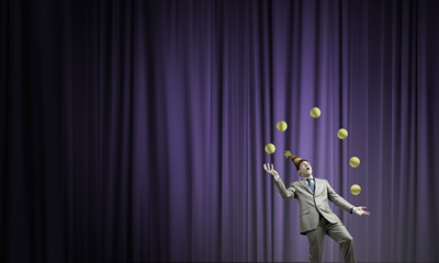 Businessman juggling with balls