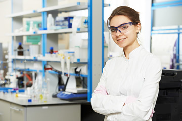 Woman chemist scientist researcher in laboratory