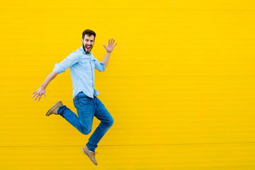 Poster Dance School men jumping on yellow background
