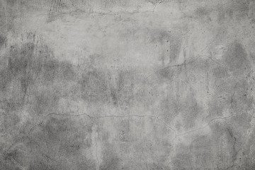 Grunge concrete cement wall with cracks.