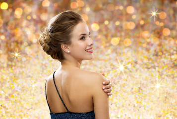 smiling woman in evening dress from back
