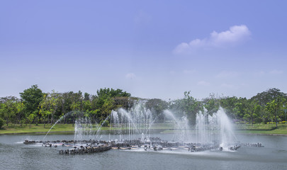 fountain in pond in garden, bangkok, thailand