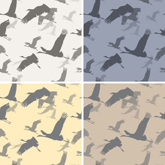 Four seamless texture with silhouettes flying cranes
