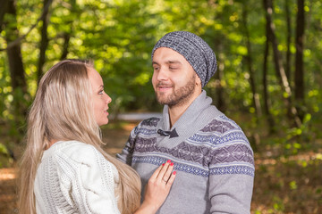 Young couple in autumn park