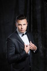 Portrait of a man in black classic suit.