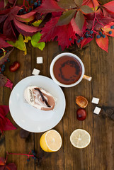 cup of tea with autumn leaves of wild grapes