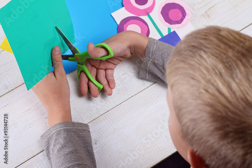 Child Cut Out Of Colored Paper Kid Making Birthday Card