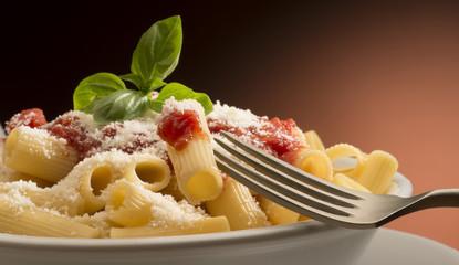 dish with macaroni and tomato sauce