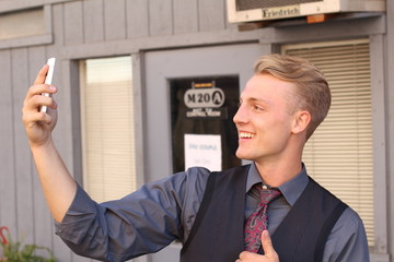 Handsome businessman taking a selfie with a mobile phone