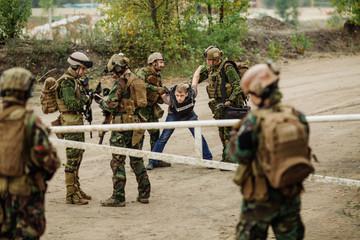 rangers with weapon captured journalist hostage