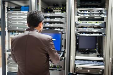People fix server network in data room