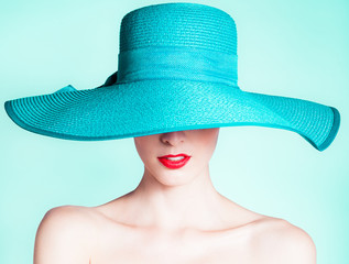 Woman wearing hat. Fashion studio portrait