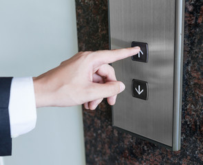 Man pressing elevator button