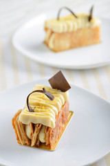 two pieces of napoleon cake on white plate