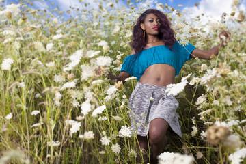 Beautiful African American girl enjoys summer day.
