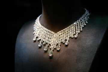 Necklace made of white gold with diamonds on a stand.