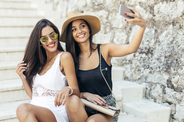 Friends taking selfie of themselves