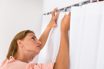 Woman Putting Curtain