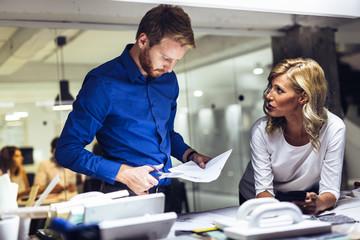 Man and women designing in studio