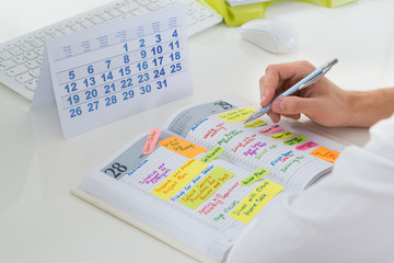 Fototapete - Businessman With Calendar And Diary