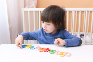 Two-year-old boy plays the numbers
