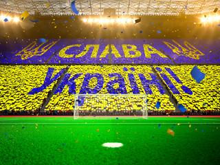 Flag Ukraine of fans. Evening stadium arena Yellow