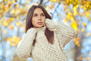 Beautiful woman in a sweater in park