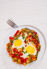 fried eggs with mixed vegetables on plate