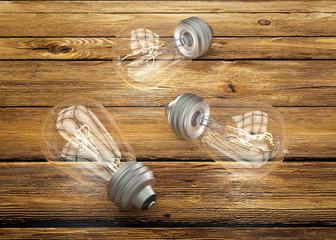 Vintage light bulbs on brown wood background
