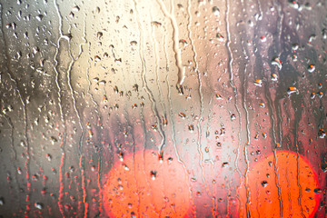 Drops Of Rain On Blue Glass Background. Street Bokeh Lights Out