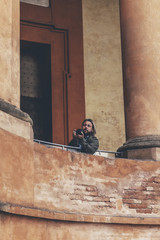 Man taking pictures of architecture at San Luca in Bologna, Ital