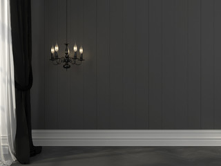 Black chandelier on a background of gray wall