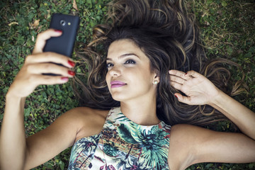 Beautiful girl take a selfie using a mobile phone