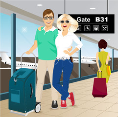 happy couple standing at the airport
