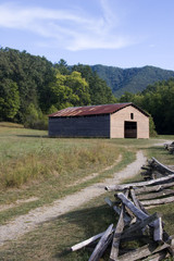 Tipton Place Historic Old Barn at Cades Cove with Split Rail Fence