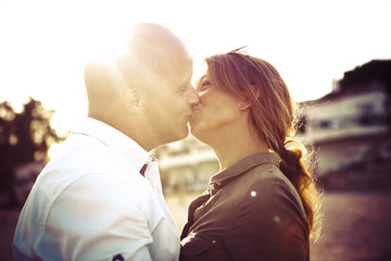 Spain, Majorca, Alcudia, kissing couple at backlight