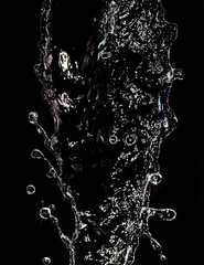 spray water on a black background