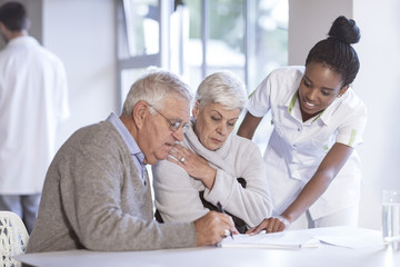 Nurse caring for senior couple