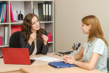 The manager listens attentively to a client