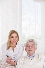 Happy old male and nice nurse