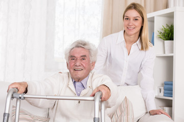 Granddaughter supporting her granddad