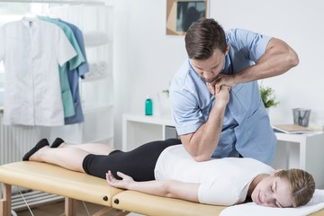 Physiotherapist massaging womans back