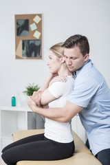 Chiropractor helping woman with pain