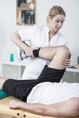 Female physiotherapist working with patient