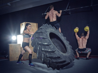Three CrossFit athletes at workout