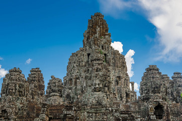 Ancient stone faces Bayon temple in Angkor Thom, Siemreap, Cambo