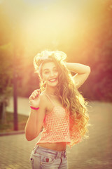 Pin-up girl with a lollipop and straightens long hair.