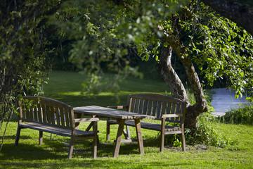 Wooden furniture in a garden.