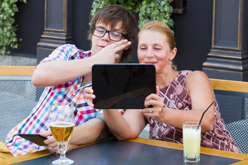 Mother and son using a tablet talk
